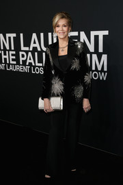Jane Fonda looked classy in an embellished black pantsuit at the Saint Laurent show.
