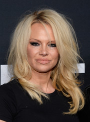 Pamela Anderson channeled Brigitte Bardot with this teased 'do at the Saint Laurent show.