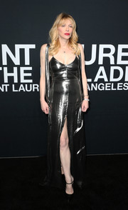 Courtney Love donned a slinky pewter gown by Saint Laurent for the label's show.