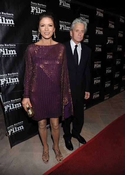 Catherine Zeta Jones dazzled on the red carpet in a purple frock paired with glittering gold strappy sandals.