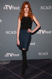 Katherine McNamara dressed up her plain top with an embroidered blue mini skirt.