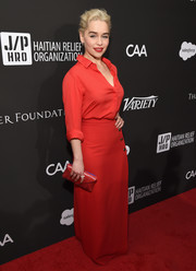 Emilia Clarke went for an all-red envelope clutch, blouse, and skirt combo at the Haiti Rising Gala.