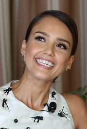 Jessica Alba attended the SELF luncheon wearing her hair in a sleek, elegant chignon.