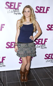 Lenay Dunn attended the 'Self' magazine event wearing tan leather cowboy boots.