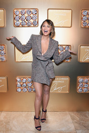 Chrissy Teigen showed off her cleavage and legs in a ruffled silver blazer dress at the SEPHORiA: House of Beauty event.