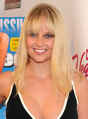 Genevieve Morton wore her blonde hair straight with youthful bangs at the SI Swimsuit launch party.
