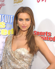 Irina Shayk styled her honey-brown hair in a sleek straight cut at the 'SI' swimsuit launch hosted by Pranna.