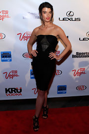 Crystal Renn donned a chic cocktail dress paired with black strappy sandals.