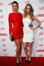 Julie Henderson dazzled in black satin peep toe platforms, the perfect complement to her red long sleeved mini dress.