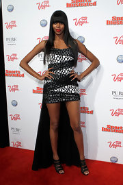 Jessica White looked modern and chic in a sexy cocktail dress that she paired with bright red lips for a pop of color. To finish off the look, Jessica opted for long sleek locks and straight bangs.