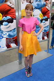 Jayma went for bold, color-blocked hues at the 'Smurfs 2' premiere where she donned a hot pink top with an orange skirt.