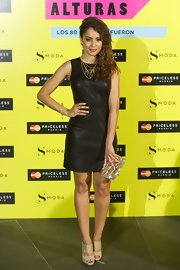 Hiba kept her look simple and chic with a sleeveless black leather frock.