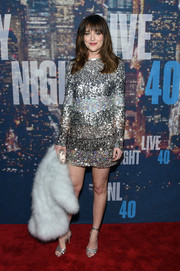 Dakota Johnson added more shine with a pair of silver ankle-strap heels by Gianvito Rossi.