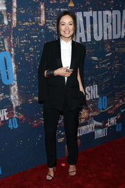 Olivia Wilde went for mannish appeal in a caped black pantsuit from the H&M Conscious Exclusive collection during the SNL 40th anniversary celebration.