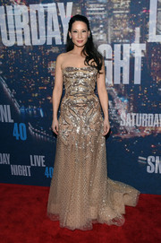 Lucy Liu graced the SNL 40th anniversary red carpet wearing a sparkly nude strapless gown by Zuhair Murad Couture.
