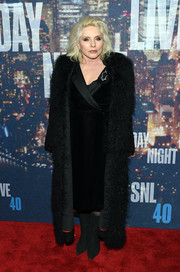 Debbie Harry looked ultra glam in a black fur coat layered over a tux-style wrap dress at the SNL 40th anniversary celebration.