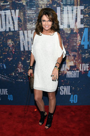 Sarah Palin channeled her daughter in a sequined, cold-shoulder LWD during the SNL 40th anniversary celebration.