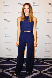 Katherine McPhee matched her top with a pair of flared blue pants.