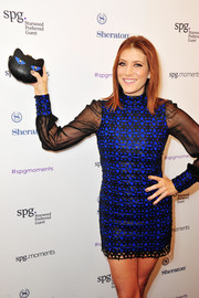 Kate Walsh showed off a cute cat clutch while attending the SPG Hear the Music, See the World performance.