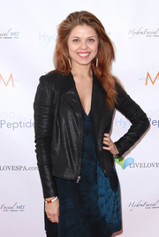 Anna Trebunskaya added subtle shimmer to her outfit with a shiny black zip-up jacket when she attended the Live Love Spa event.