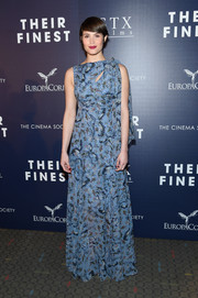 Gemma Arterton attended the premiere of 'Their Finest' wearing a floor-length Erdem print dress with a slashed yoke.