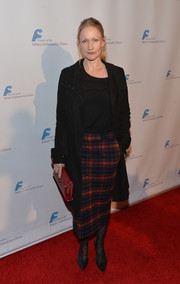 Paula Malcomson attended the Saban Community Clinic dinner gala looking cozy in a black wool coat.