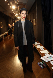 Caroline Issa attended the Sachin & Babi fashion show rocking a fuzzy black coat.