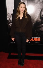 Taissa Farmiga topped off her ensemble with black lace-up boots.