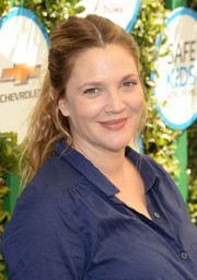 Drew Barrymore attended Safe Kids Day wearing a casual center-parted ponytail.