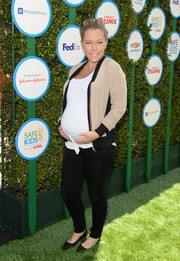Kendra Wilkinson looked relaxed in a pink and black zip-up jacket teamed with skinny jeans during Safe Kids Day.