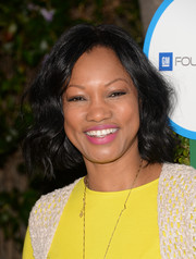 Garcelle Beauvais topped off her Safe Kids Day look with a sweet wavy 'do
