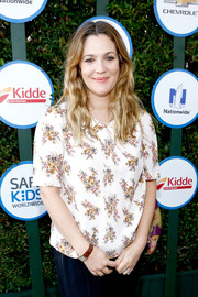 Drew Barrymore attended Safe Kids Day wearing a rectangle-faced watch with a brown leather band.