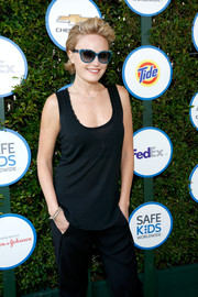 Malin Akerman accessorized with a chic pair of blue-rimmed cateye sunnies when she attended Safe Kids Day.