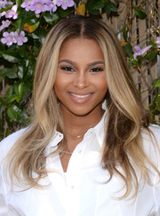 Ciara wore her hair down with subtle waves and a center part during Safe Kids Day.