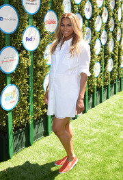 Ciara chose a pair of red suede slip-ons by Prada to team with her maternity dress.