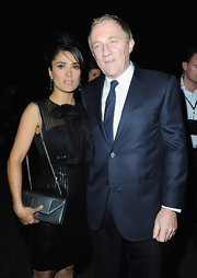 Salma Hayek accessorized her sparkly, sheer LBD with a striking black chain strap bag.