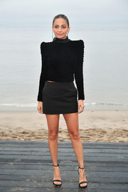 Nicole Richie sported a pointy-shouldered black turtleneck at the Saint Laurent Men's Spring '20 show.