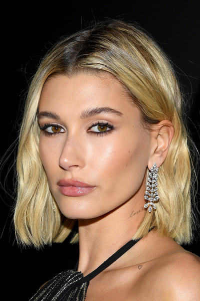 More Pics of Hailey Bieber Lettering Tattoo (1 of 7) - Tattoos Lookbook - StyleBistro [hair,face,eyebrow,hairstyle,blond,chin,lip,cheek,beauty,nose,hailey bieber,saint laurent,part,paris,france,paris fashion week womenswear fall,saint laurent : photocall - paris fashion week womenswear fall,bangs,hair,hair m,layered hair,long hair,artificial hair integrations,blond,brown hair,forehead,fashion]