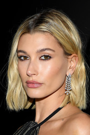 Hailey Bieber sports a 'Lover' tattoo on her neck.