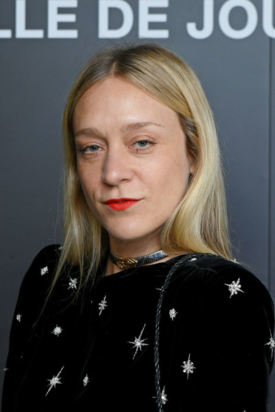 For her outfit, Chloe Sevigny paired a silver choker with a star-embellished dress.