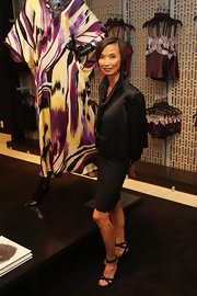 Fashion designer Josie Natori wore her hair in a classic bob with a side-part.