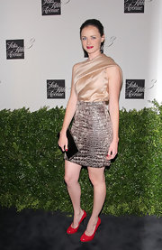 Alexis was gorgeous in a draped champagne bodice with an exotic skin skirt.