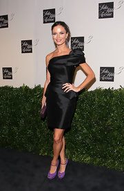 Georgina gave her satin, one-shoulder dress and youthful appeal with purple accents, including suede, peep toe pumps.