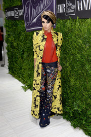 Stacey Bendet showed off her eclectic style with this printed coat, red top, and embellished jeans combo.