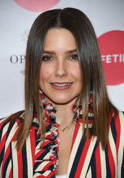 Sophia Bush wore her hair just past her shoulders in a sleek straight style with choppy ends at the 'Opposite of Hate' book launch.