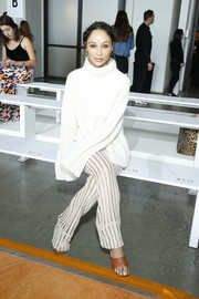 Cara Santana completed her outfit with a pair of sheer knit pants, also by Sally LaPointe.