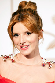 Bella Thorne sported a knotted high bun with center-parted bangs during the LoveGold party honoring Lupita Nyong'o.