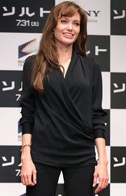Angelina wore a casual, long hairstyle with shaped bangs swept to the side.