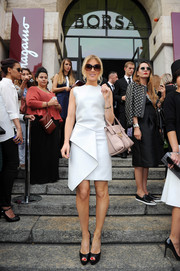 Hofit Golan chose a stylish little white dress with folded detailing for the Salvatore Ferragamo fashion show.