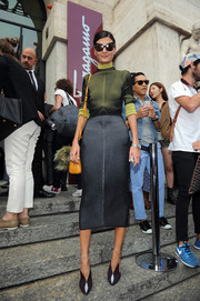 Giovanna Battaglia went for a stylish modern look with this yellow and blue sweater dress when she attended the Salvatore Ferragamo fashion show.